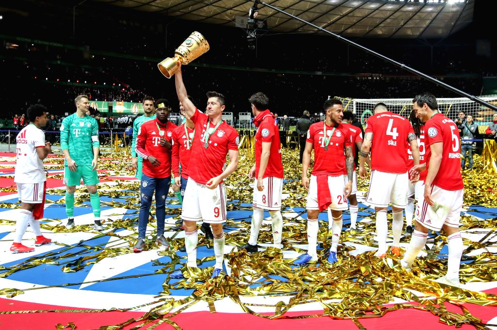 BERLIN, May 26, 2019 - Bayern Munich's Robert Lewandowski (front) celebrates victory after the German Cup final between RB Leipzig and FC Bayern Munich in Berlin, capital of Germany, May 25, 2019. ...