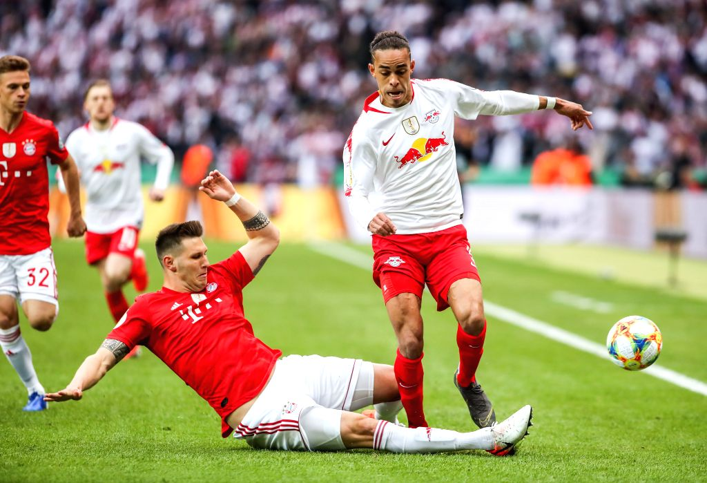 BERLIN, May 26, 2019 - Leipzig's Yussuf Poulsen (R) vies with Bayern Munich's Niklas Suele (bottom) during the German Cup final between RB Leipzig and FC Bayern Munich in Berlin, capital of Germany, ...
