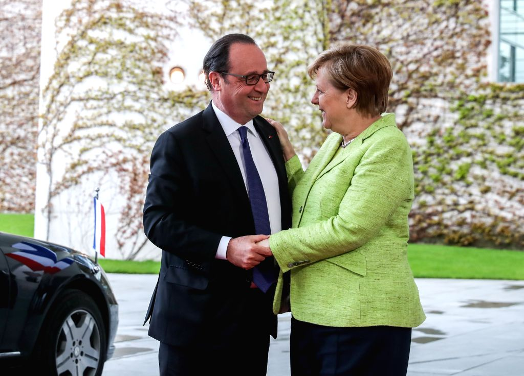 BERLIN, May 8, 2017 - Visiting French President Francois Hollande (L) talks with German Chancellor Angela Merkel in Berlin, capital of Germany, on May 8, 2017. Outgoing French President Francois ...