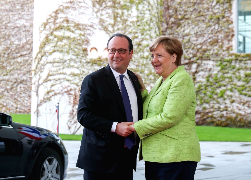BERLIN, May 8, 2017 - Visiting French President Francois Hollande (L) and German Chancellor Angela Merkel pose for photos in Berlin, capital of Germany, on May 8, 2017. Outgoing French President ...