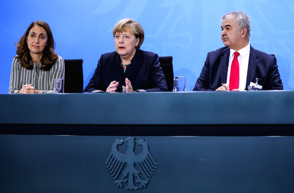 BERLIN, Nov. 14, 2016 - German Chancellor Angela Merkel (C) attends a news conference after the 9th German Integration Summit in Berlin, capital of Germany, on Nov. 14, 2016. The 9th German ...