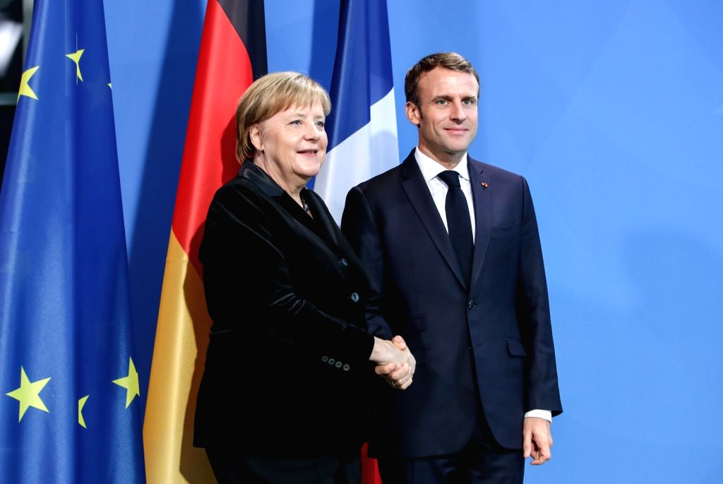 BERLIN, Nov. 18, 2018 (Xinhua) -- German Chancellor Angela Merkel (L) shakes hands with French President Emmanuel Macron after a joint press conference at German Chancellery in Berlin, capital of Germany, on Nov. 18, 2018. Visiting French President E