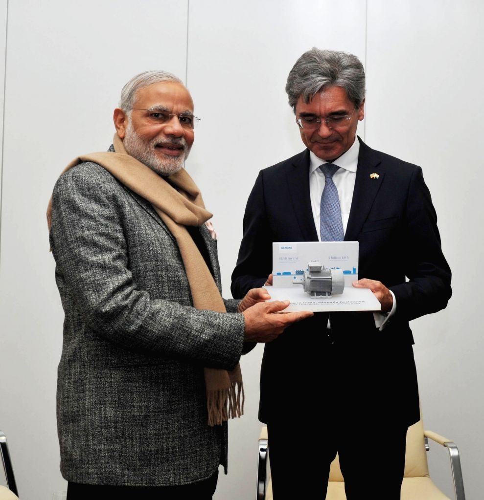 Prime Minister Narendra Modi being presented a memento, during his visit to the Siemens Technical Academy, at Berlin, in Germany on April 13, 2015. - Narendra Modi