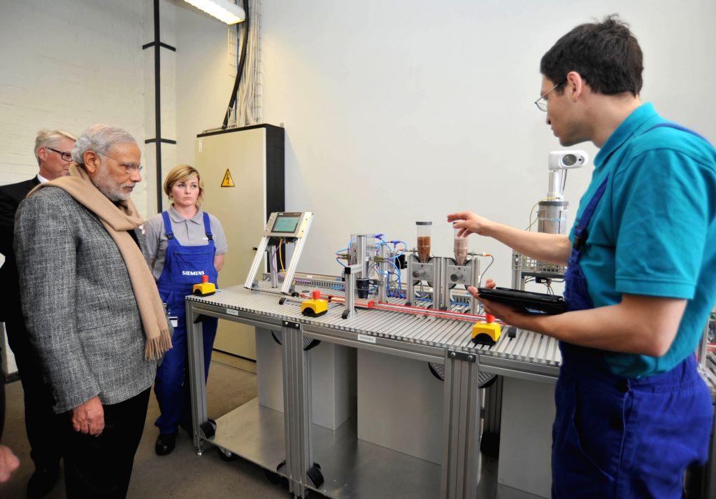 Prime Minister Narendra Modi visits the Siemens Technical Academy, at Berlin, in Germany on April 13, 2015. - Narendra Modi