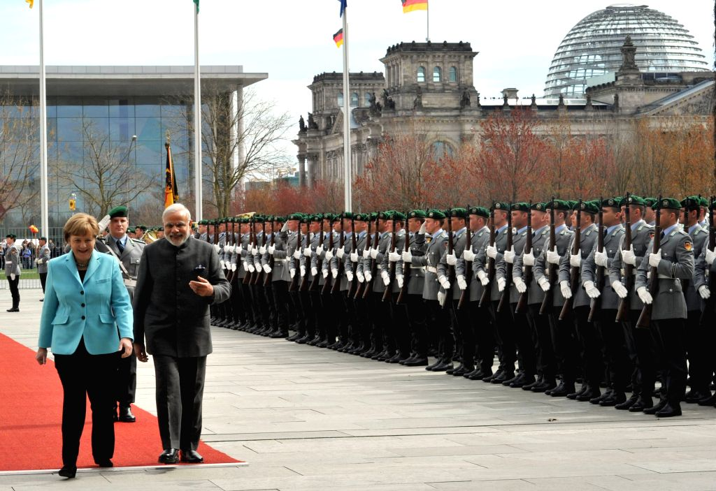 Prime Minister Narendra Modi with the German Chancellor Angela Merkel, during the Ceremonial Welcome, in Berlin, Germany on April 14, 2015. - Narendra Modi