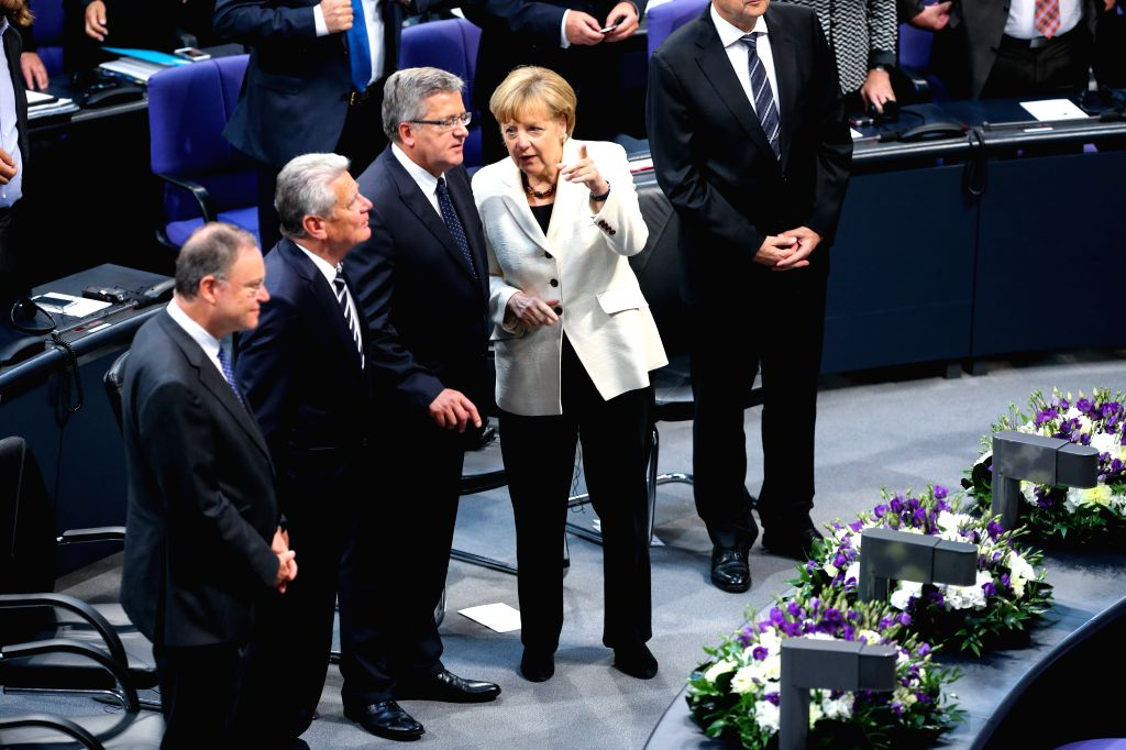 German Chancellor Angela Merkel (2nd R) and President of Poland Bronislaw Komorowski (3rd R) attend a memorial session for the 75th anniversary of the breaking of ..