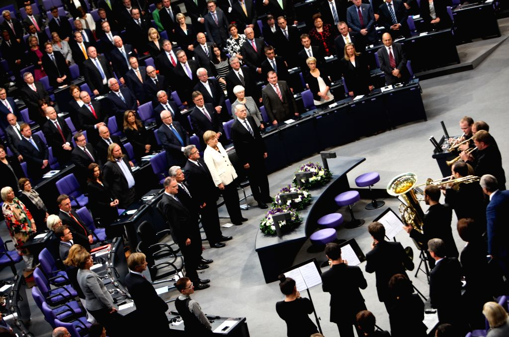 German Chancellor Angela Merkel (2nd R, center) and President of Poland Bronislaw Komorowski (3rd R, center) attend a memorial session for the 75th anniversary of ..
