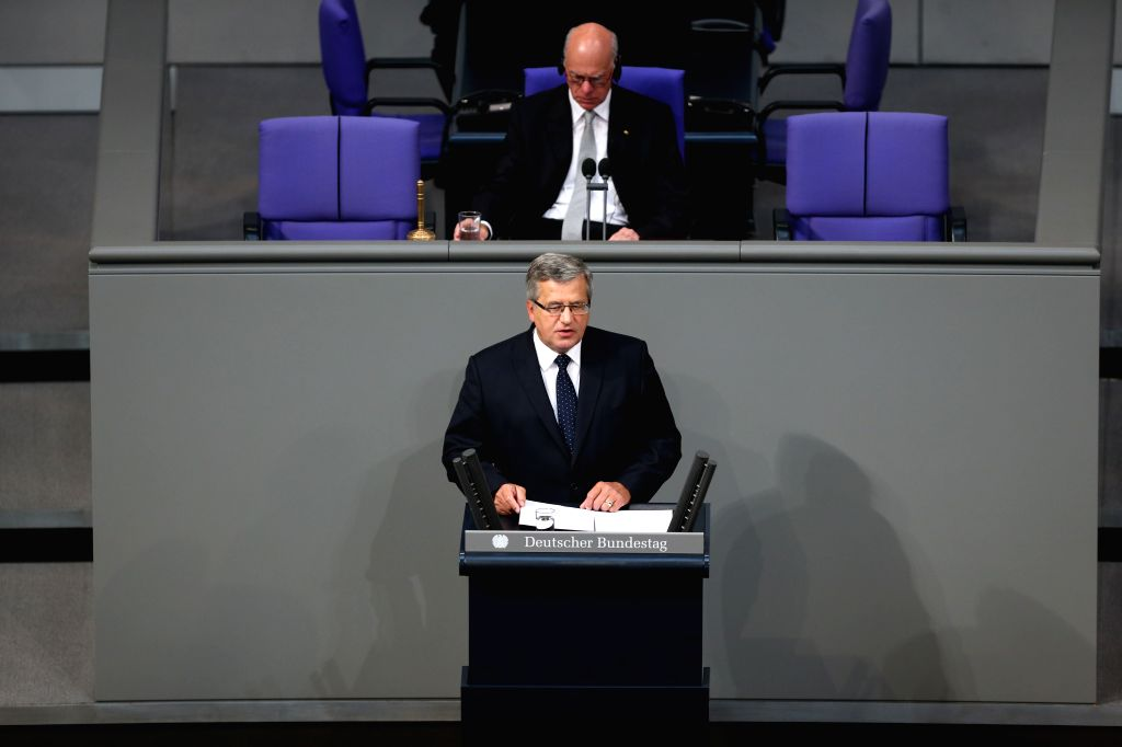 President of Poland Bronislaw Komorowski (front) speaks during a memorial session for the 75th anniversary of the breaking of World War II at the Bundestag, the ...