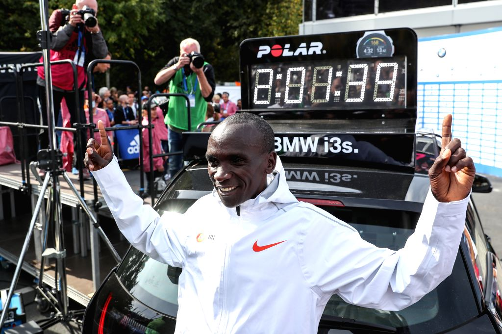 BERLIN, Sept. 16, 2018 - Kenya's Eliud Kipchoge poses for photos with the vehicle displaying his new world record during the Berlin Marathon 2018 in Berlin, capital of Germany, on Sept. 16, 2018. The ...