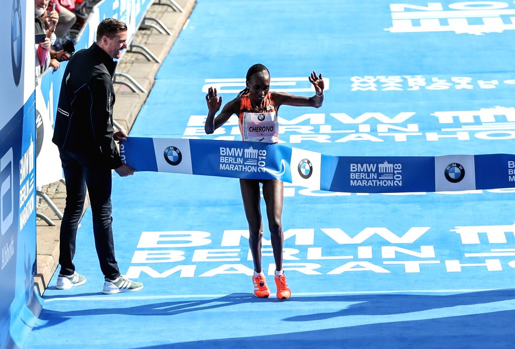 BERLIN, Sept. 16, 2018 - Kenya's Gladys Cherono (R) crosses the finishing line during the Berlin Marathon 2018 in Berlin, capital of Germany, on Sept. 16, 2018. The Berlin Marathon 2018 kicked off in ...