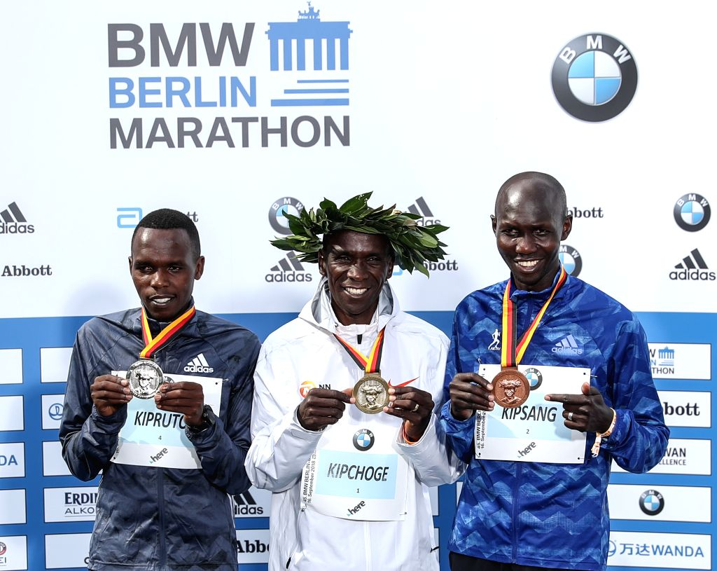BERLIN, Sept. 16, 2018 - Men's gold medalist Kenya's Eliud Kipchoge (C) poses for photos with silver medalist Kenya's Amos Kipruto (L) and bronze medalist Kenya's Wilson Kipsang during the award ...