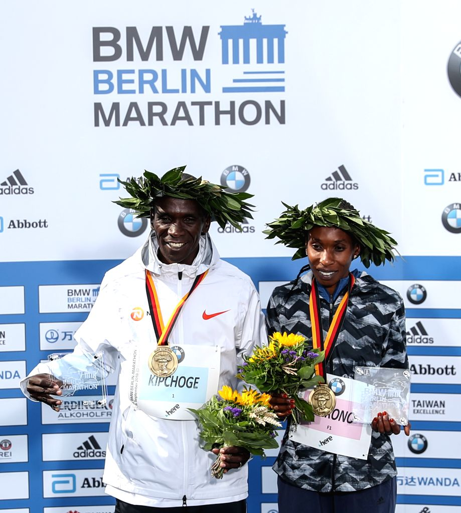 BERLIN, Sept. 16, 2018 - Men's gold medalist Kenya's Eliud Kipchoge (L) and Women's gold medalist Kenya's Gladys Cherono pose for photos during the award ceremony of the Berlin Marathon 2018 in ...