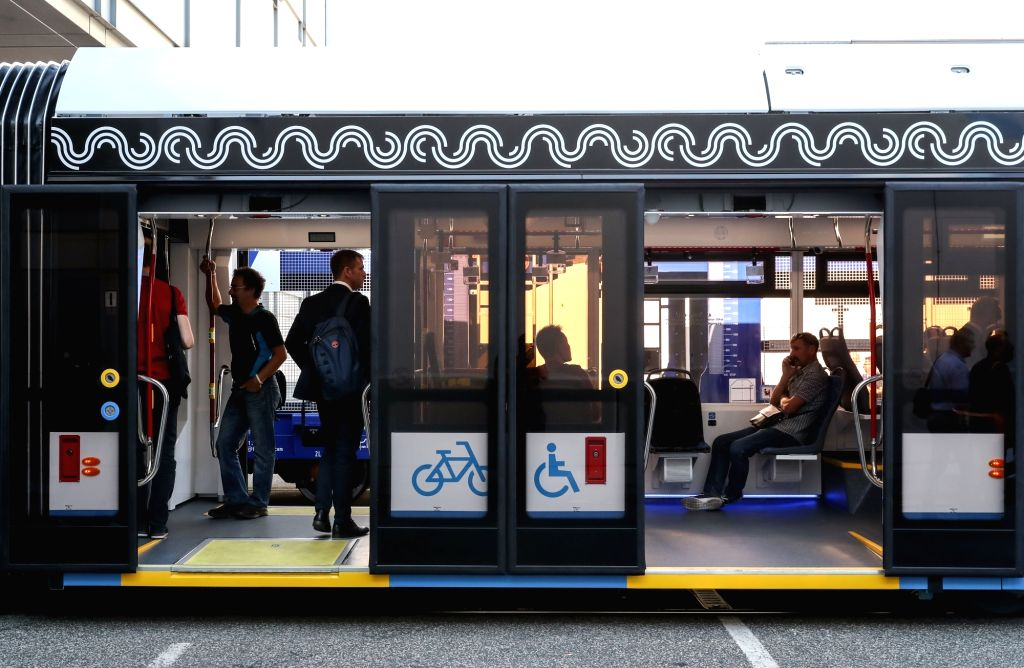 """BERLIN, Sept. 18, 2018 - Visitors ride a train displayed at the """"Innotrans"""" railway industry trade fair in Berlin, capital of Germany, on Sept. 18, 2018. The bi-annual """"Innotrans"""" ..."""