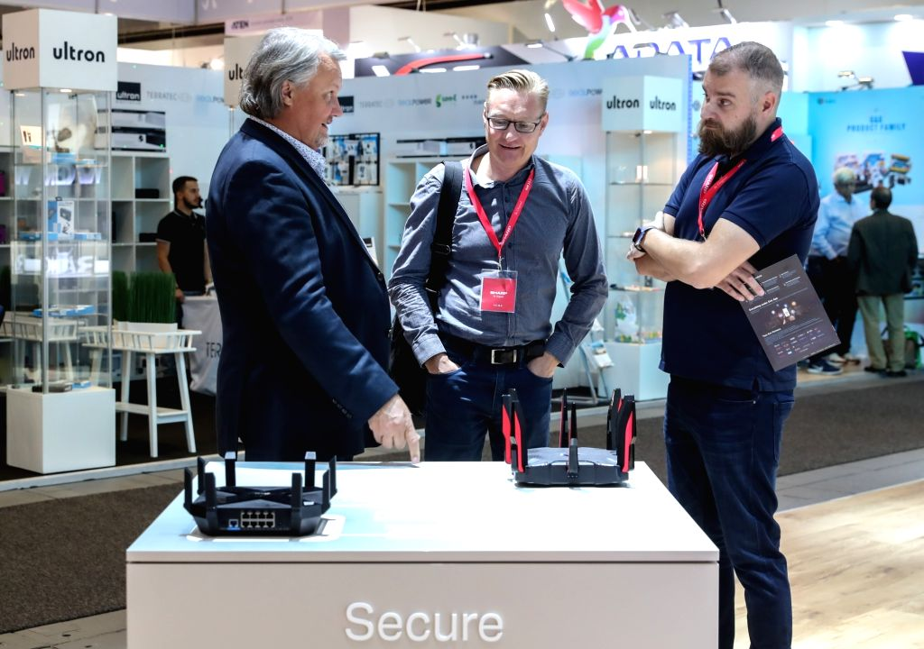 BERLIN, Sept. 5, 2018 - Visitors learn about wireless routers displayed at the booth of TP-Link during the 2018 IFA consumer electronics fair in Berlin, capital of Germany, on Sept. 5, 2018. The IFA ...