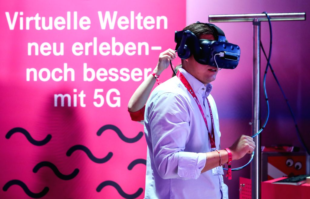 BERLIN, Sept. 6, 2019 - A visitor wears a VR device with 5G support at the booth of Telekom during the 2019 IFA fair in Berlin, capital of Germany, on Sept. 6, 2019. The 59th Consumer Electronics ...