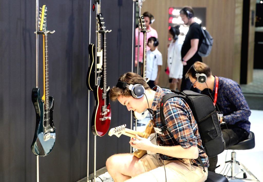 BERLIN, Sept. 6, 2019 - Visitors play musical instruments at the booth of Yamaha during the 2019 IFA fair in Berlin, capital of Germany, on Sept. 6, 2019. The 59th Consumer Electronics Unlimited ...