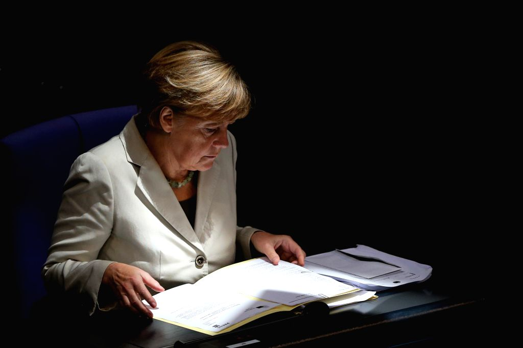 German Chancellor Angela Merkel attends a debate on the 2015 federal budget at the Bundestag, the lower house of parliament, in Berlin, Germany, on Sept. 9, 2014. ...