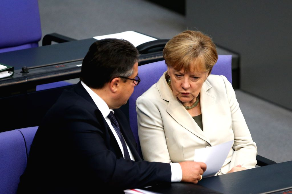 German Chancellor Angela Merkel (R) speaks with German Vice Chancellor, Economy and Energy Minister Sigmar Gabriel during a debate on the 2015 federal budget at the . - Sigmar Gabriel