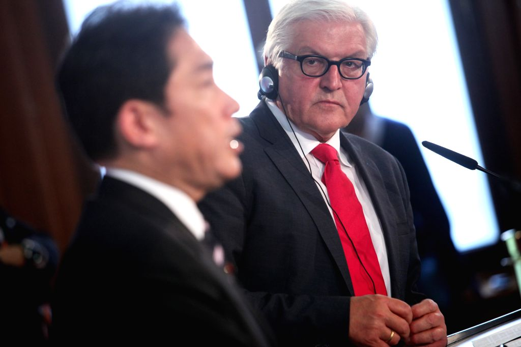 German Foreign Minister Frank-Walter Steinmeier (R) and his Japanese counterpart Fumio Kishida attend a press conference after their meeting in Berlin, Germany, on ..