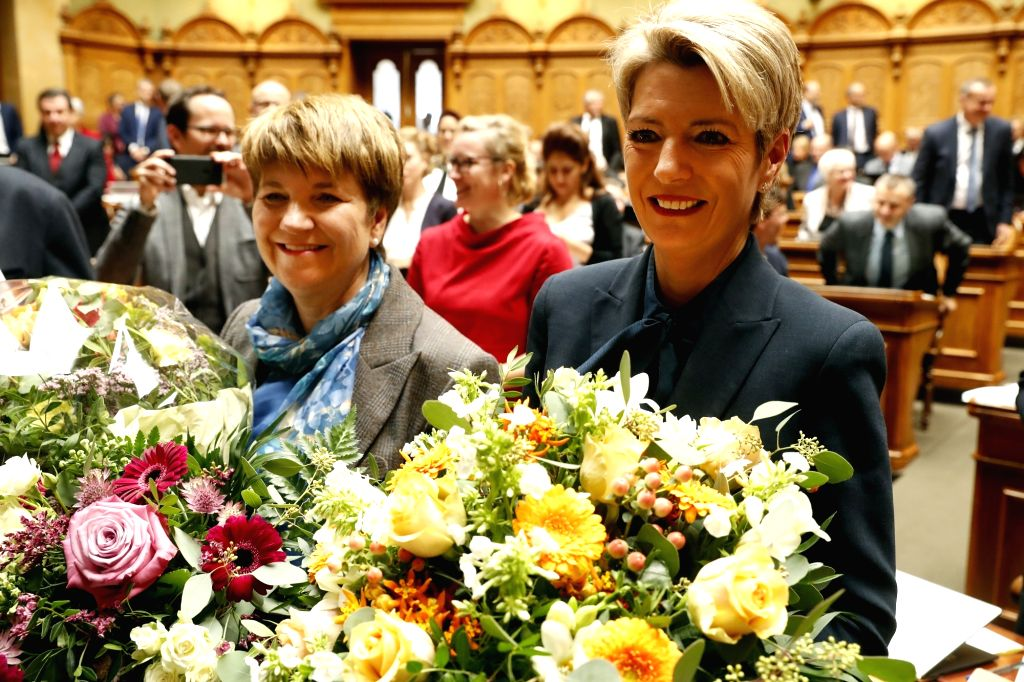 BERN, Dec. 5, 2018 - Newly-elected Federal Councilors Karin Keller-Sutter (R) and Viola Amherd pose for photos at the Federal Parliament in Bern, capital of Switzerland, Dec. 5, 2018. Switzerland's ...