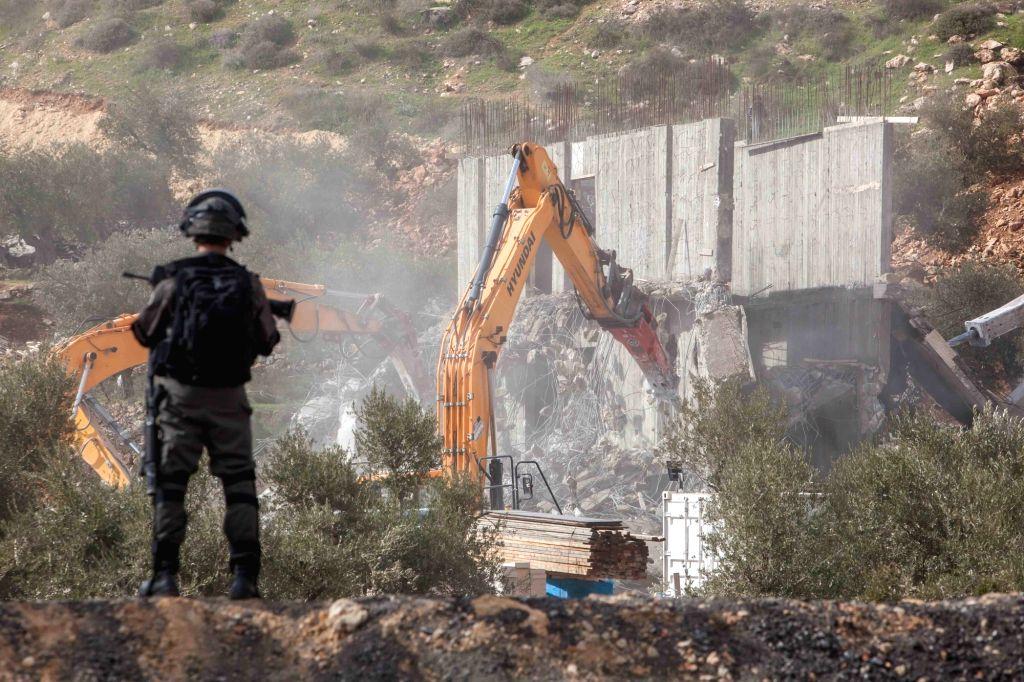 BETHLEHEM, Jan. 29, 2018 - Israeli bulldozers demolish a Palestinian house under construction in the West Bank city of Beit Jala, near Bethlehem, on Jan. 29, 2018. The Israeli army demolished two ...