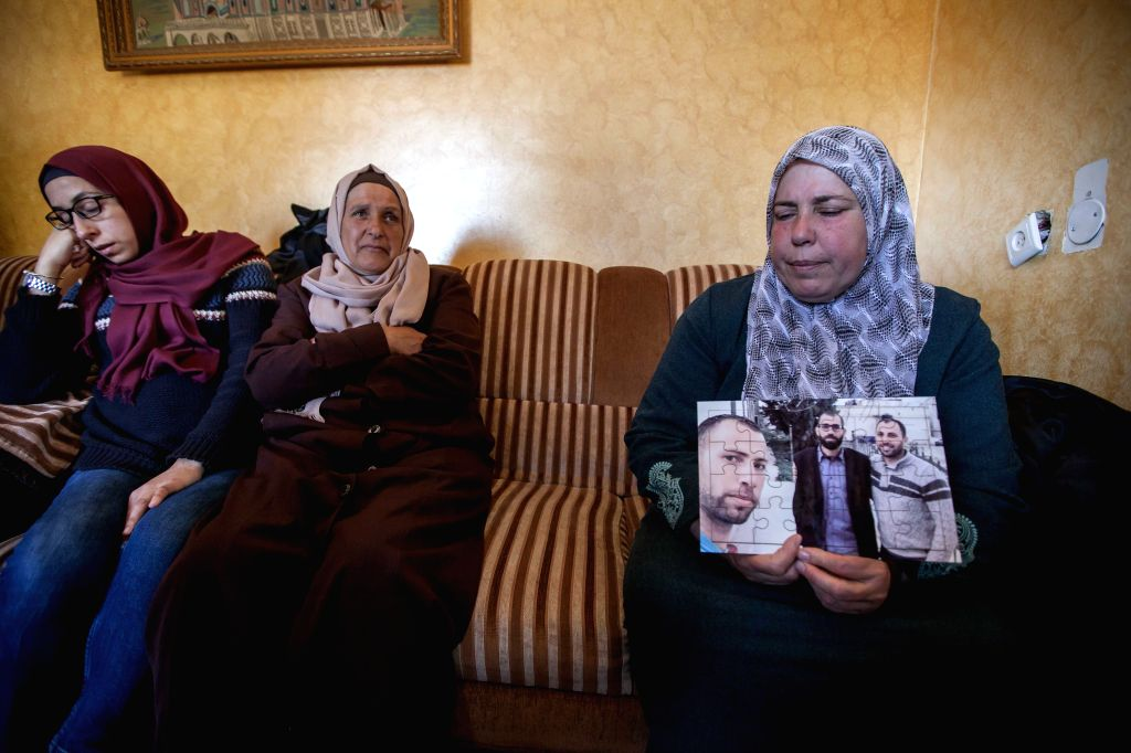 BETHLEHEM, March 6, 2017 - The mother of Bassel al-Aaraj, a Palestinian man who was reportedly killed in an exchange of fire with Israeli troops in Ramallah, shows her son's photo to the media in the ...