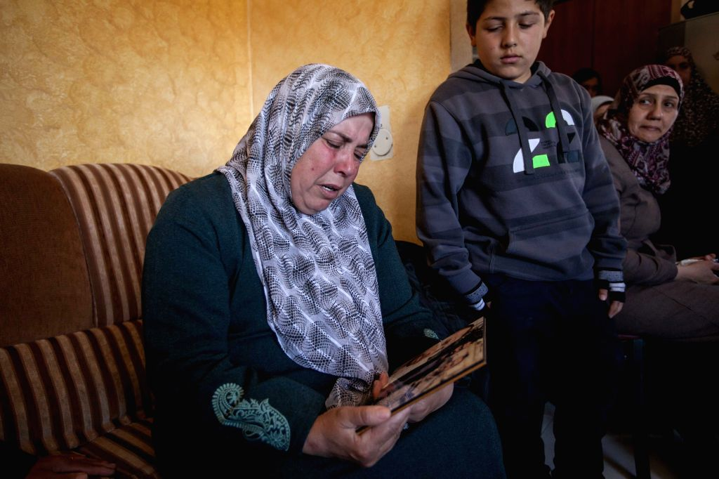 BETHLEHEM, March 6, 2017 - The mother of Bassel al-Aaraj, a Palestinian man who was reportedly killed in an exchange of fire with Israeli troops in Ramallah, cries as she looks at his son's photo in ...
