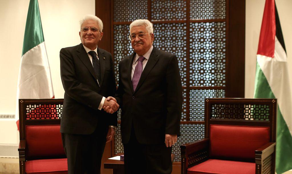 BETHLEHEM, Nov. 1, 2016 - Palestinian President Mahmoud Abbas (R) shakes hands with Italian President Sergio Mattarella during their meeting in the West Bank city of Bethlehem, on Nov. 1, 2016.
