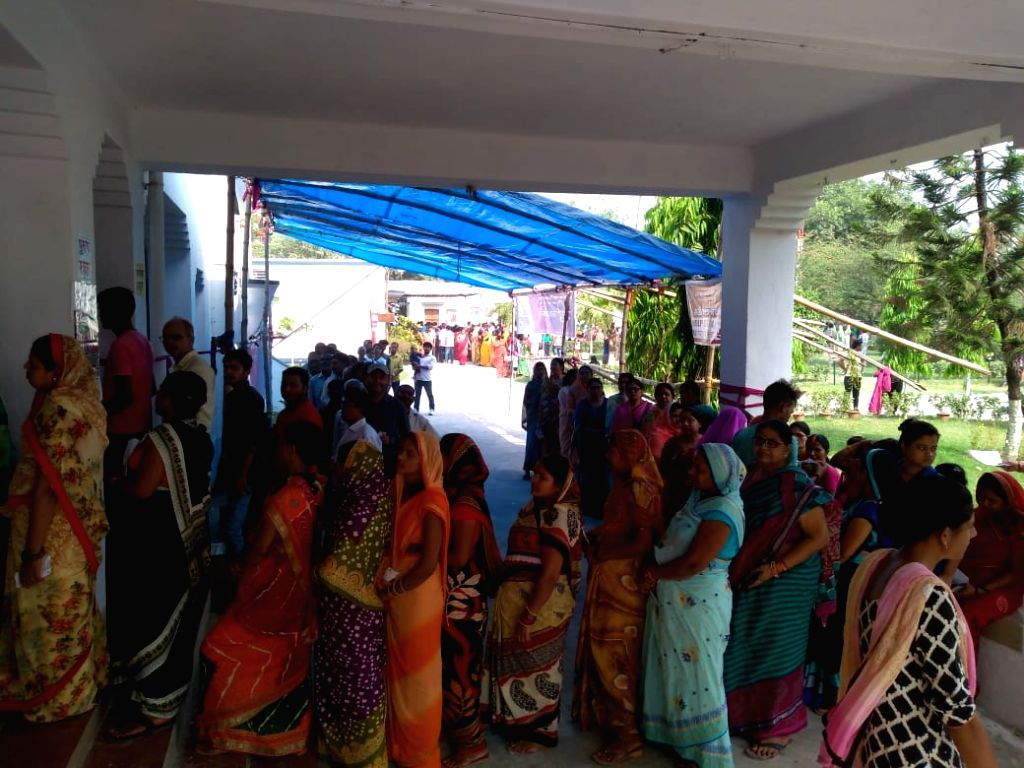 Betia (Bihar): Women queue up to cast their votes during the sixth phase of 2019 Lok Sabha elections, in Betia, Bihar on May 12, 2019.