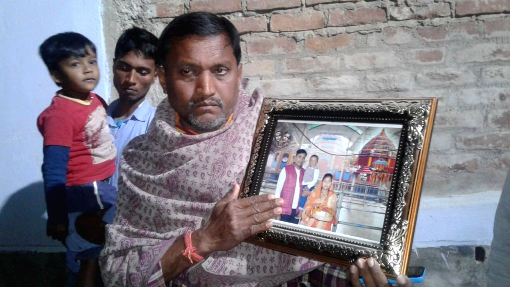 Bhagalpur (Bihar): Grief struck family members of Ratan Kumar Thakur, one of the 45 CRPF personnel killed in a suicide attack by militants in Jammu and Kashmir's Pulwama district on 14th Feb 2019; in ... - Kumar Thakur