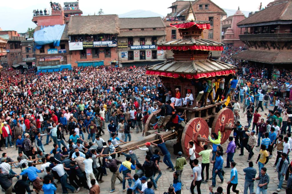 Devotees pull the chariot of god Bhairabhnath during Bisket Jatra festival at Bhaktapur, Nepal, April 10, 2014. Bisket Jatra festival is celebrated to welcome ...