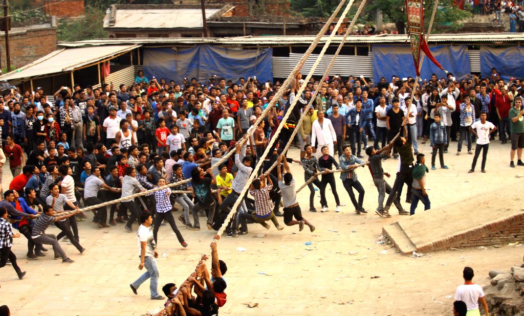 BHAKTAPUR, April 14, 2016 - Nepalese devotees hang on the rope to pull the chariot of Bhairav during a celebration of traditional Bisket Jatra Festival, or Nepali new year, in Bhaktapur, Nepal, April ...