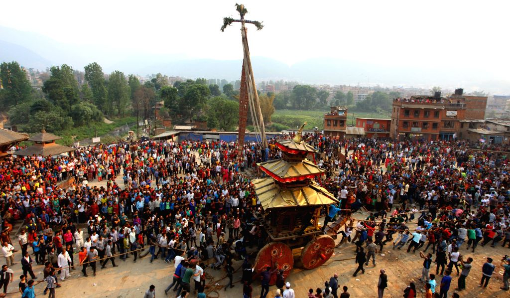 BHAKTAPUR, April 14, 2016 - Nepalese devotees pull the chariot of Bhairav near the erected long wooden pole during a celebration of traditional Bisket Jatra Festival, or Nepali new year, in ...