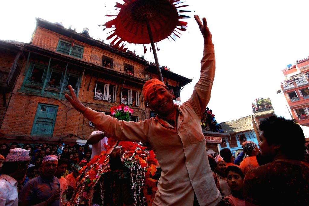 "A Nepalese man dances during the traditional ""Sindoor Jatra"" festival at Thimi, Bhaktapur, Nepal, April 15, 2014. The festival is celebrated to mark ..."