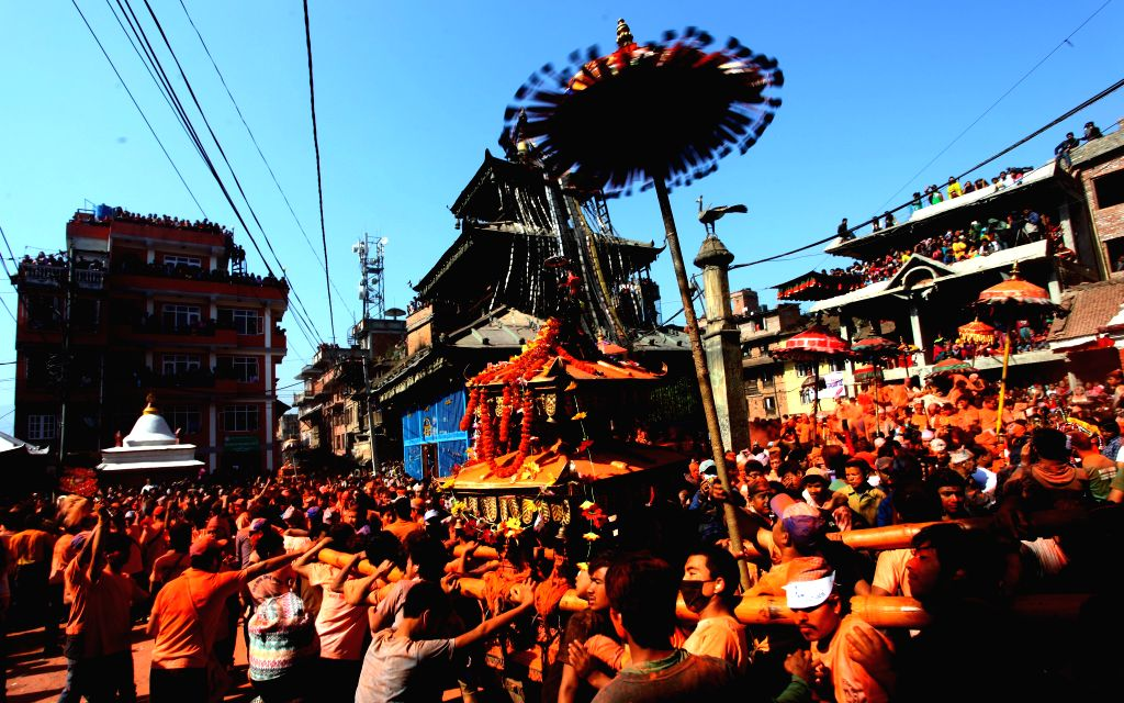 "Nepaleses carry a chariot during the traditional ""Sindoor Jatra"" festival at Thimi, Bhaktapur, Nepal, April 15, 2014. The festival is celebrated to ..."