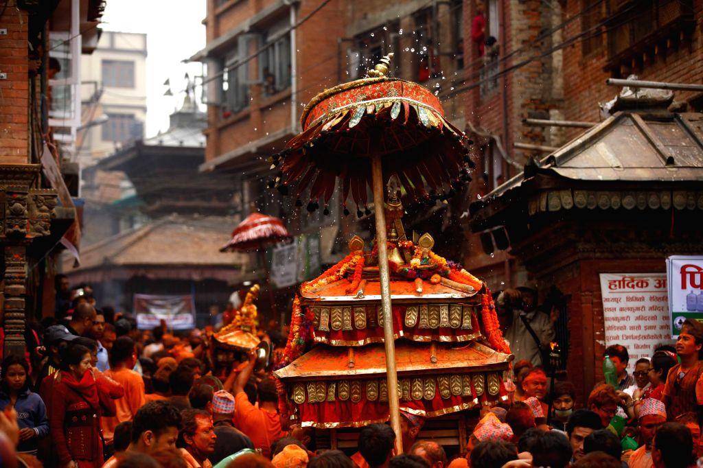 "Nepalese devotees carry the chariot during the ""Sindoor Jatra"" vermillion powder festival at Bhaktapur, near Kathmandu, Nepal, April 15, 2015. The ..."