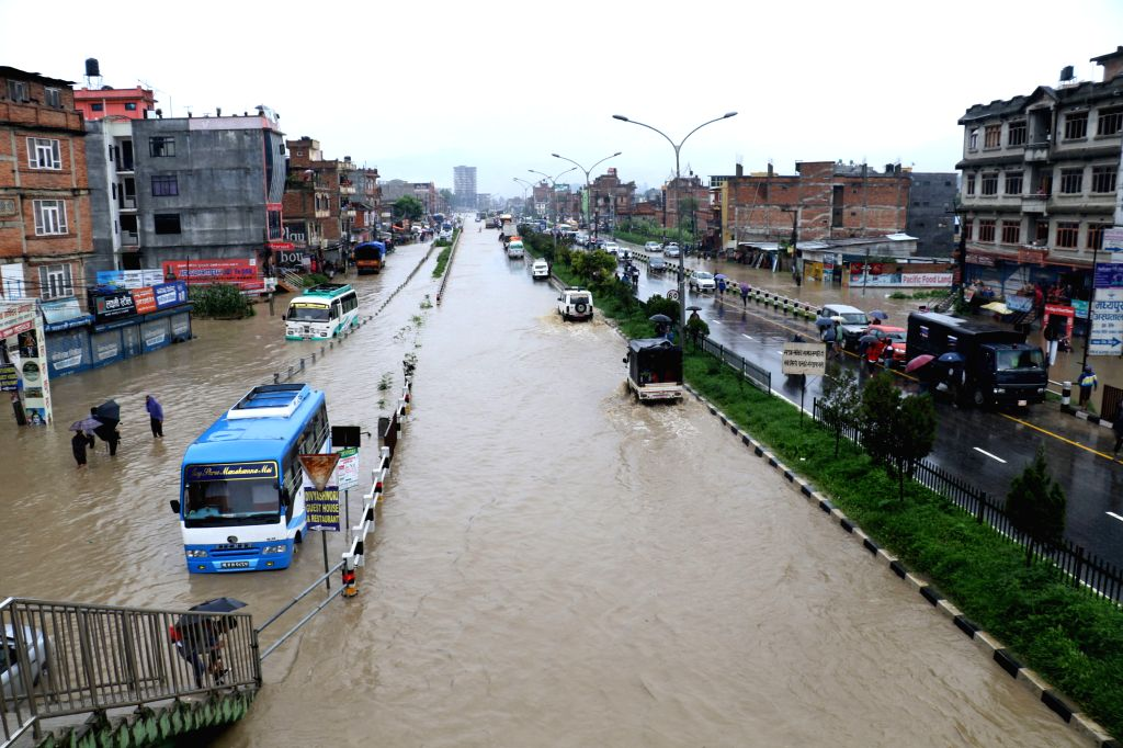 BHAKTAPUR, July 12, 2018 - Photo taken on July 12, 2018 shows a flooded street in Bhaktapur, Nepal. Many areas in Nepal were inundated due to the swollen river following torrential rains on Wednesday ...