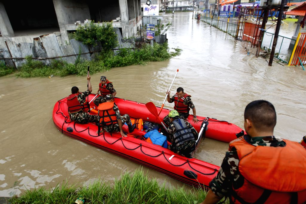 BHAKTAPUR, July 12, 2018 - Rescue workers prepare a lifesaving raft in Bhaktapur, Nepal, July 12, 2018. Many areas in Nepal were inundated due to the swollen river following torrential rains on ...