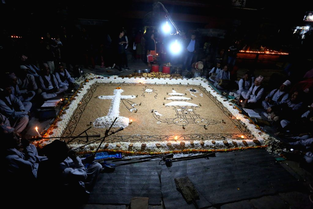 BHAKTAPUR, Nov. 13, 2019 - Members of Newar community sing religious hymns in celebration of Hali-Mali carnival by preparing the exhibition of grain, puffed corns, and fruits on the day of full moon ...