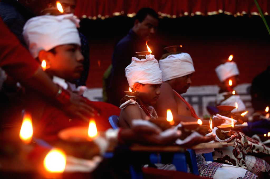 BHAKTAPUR, Oct. 8, 2019 - Hindu devotees stay with oil lamps on their heads and hands while offering prayers to Goddess Durga on Bijaya Dashami, the tenth day of the Dashain Festival which celebrates ...