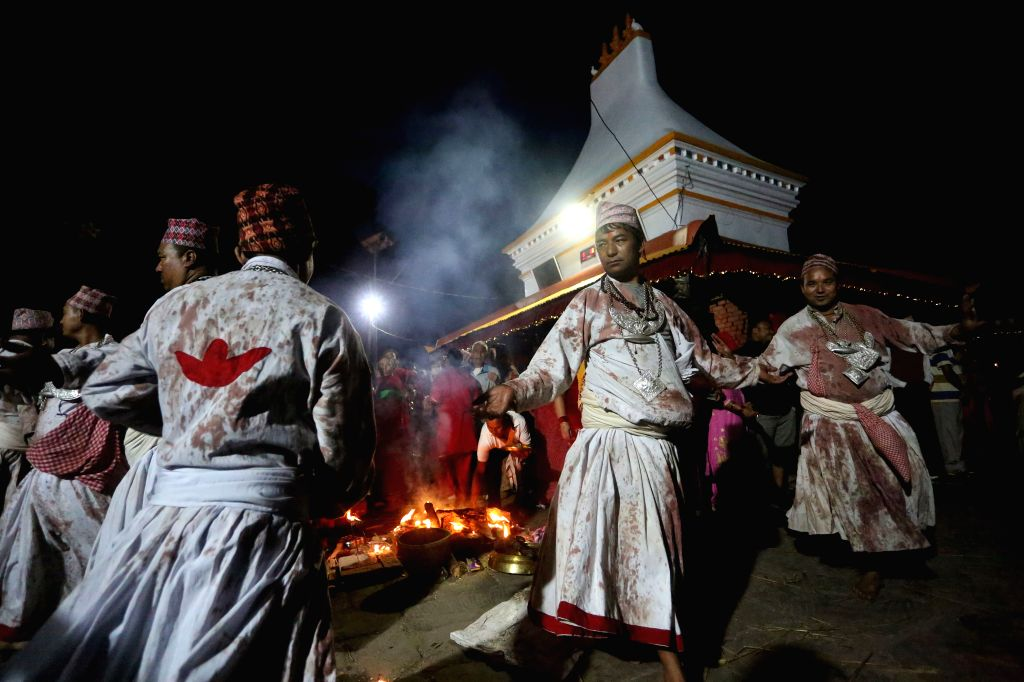 BHAKTAPUR, Oct. 8, 2019 - Hindu priests perform a religious ritual while offering prayers to Goddess Durga on Bijaya Dashami, the tenth day of the Dashain Festival which celebrates the victory of ...