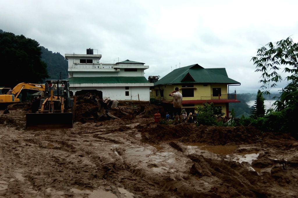 Bhalukpong (Arunachal): Earth-movers pressed into service at the spot of landslide in Bhalukpong of Arunachal Pradesh  on July 2, 2016. At least 10 bodies have been recovered from the debris.