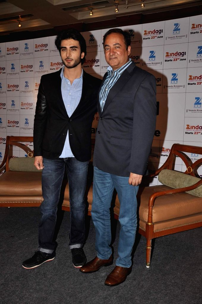Bharat Ranga, Chief Content & Creative Office, Zee Entertainment Enterprises (ZEE) and Pakistani television actor Imran Abbas during the launch of new Television channel Zindagi by Zee group in .. - Imran Abbas