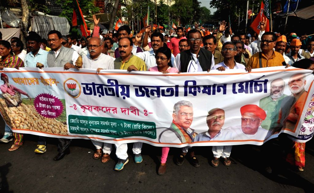 Bharatia Janata Kisan Morcha (BJKM) members take part in a protest rally against crisis sale of Potato by poor farmers in West Bengal, in Kolkata on March 14, 2017.