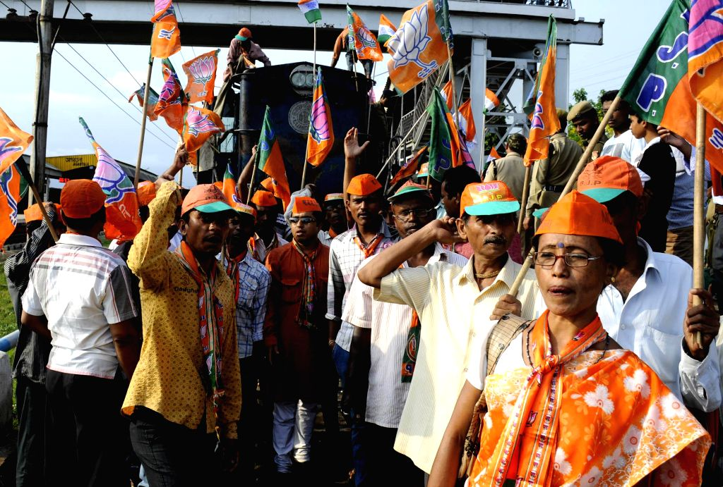 Bharatiya Janata Party (BJP) workers stage a demonstration on railway tracks disrupting railway services to press for their demands of re-elections and removal of Chief Electoral Office Ashutosh ...