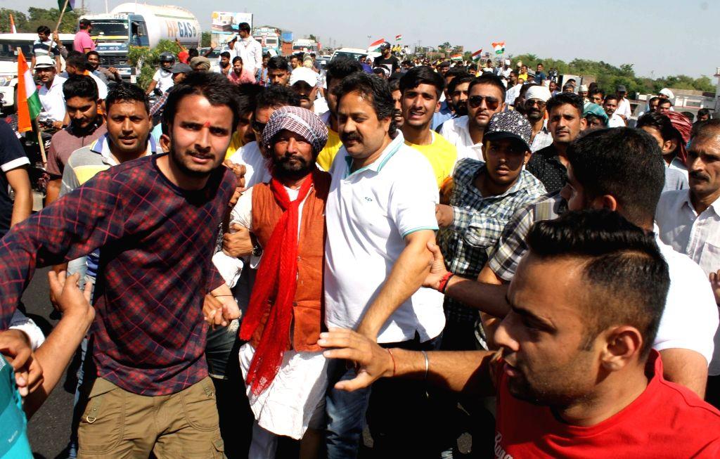 Bharatiya Janata Party leader Choudhary Lal Singh leads a march demanding CBI probe into Kathua rape and murder case in Jammu and Kashmir's Kathua district on May 20, 2018. - Choudhary Lal Singh