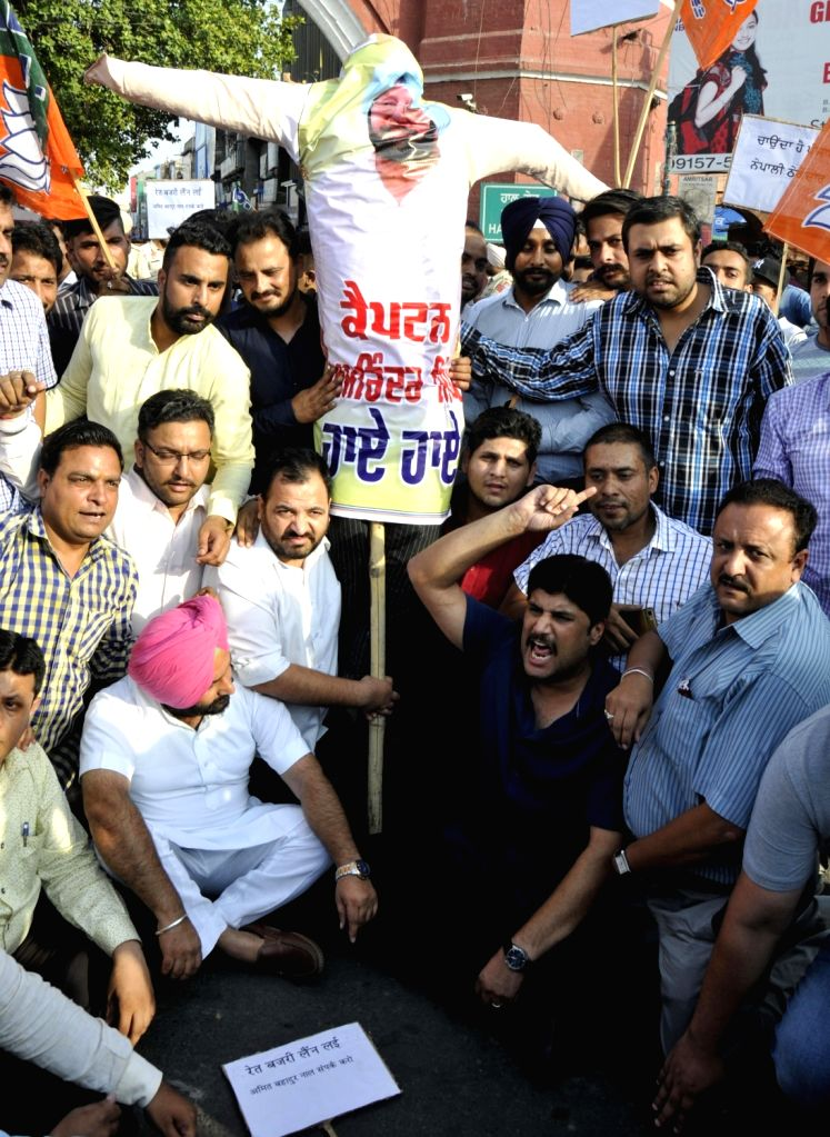 Bharatiya Janata Yuva Morcha activists stage a demonstration against Punjab Chief Minister Captain Amarinder Singh in Amritsar, on May 29, 2017. - Captain Amarinder Singh