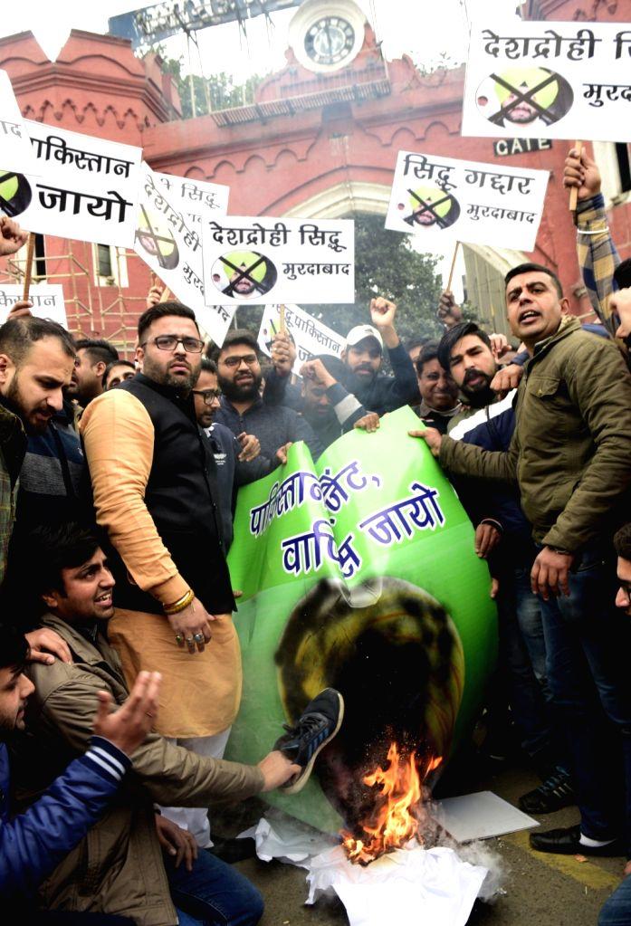 Bharatiya Janata Yuva Morcha (BJYM) activists stage a demonstration against Punjab Cabinet Minister Navjot Singh Sidhu over his remark after the Pulwama terror attack in Amritsar, on Feb ... - Navjot Singh Sidhu