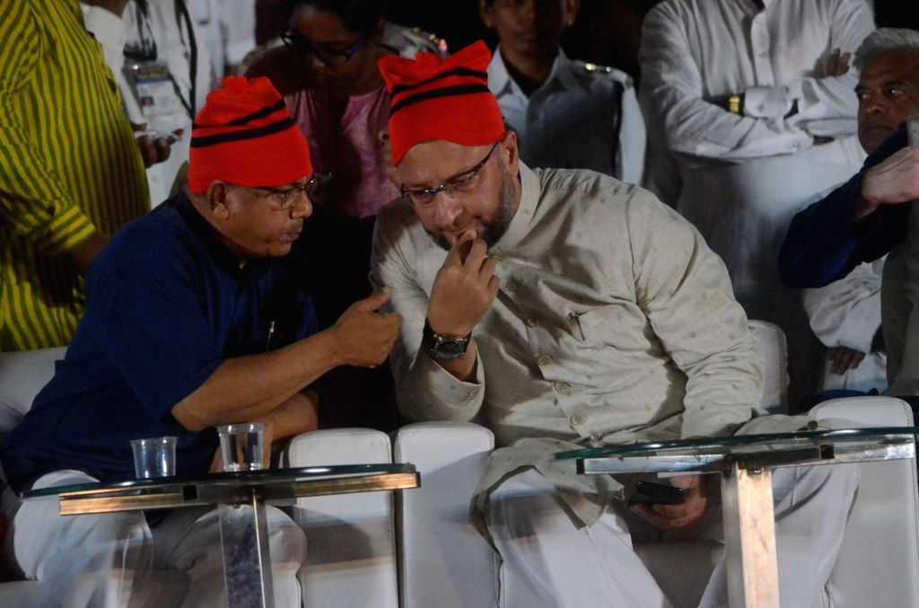 Bharip Bahujan Mahasangh (BBM) leader Prakash Ambedkar and All India Majlis-e-Ittehad-ul Muslimeen (AIMIM) President Asaduddin Owaisi interacts during a public rally for the Vanchit Bahujan ...