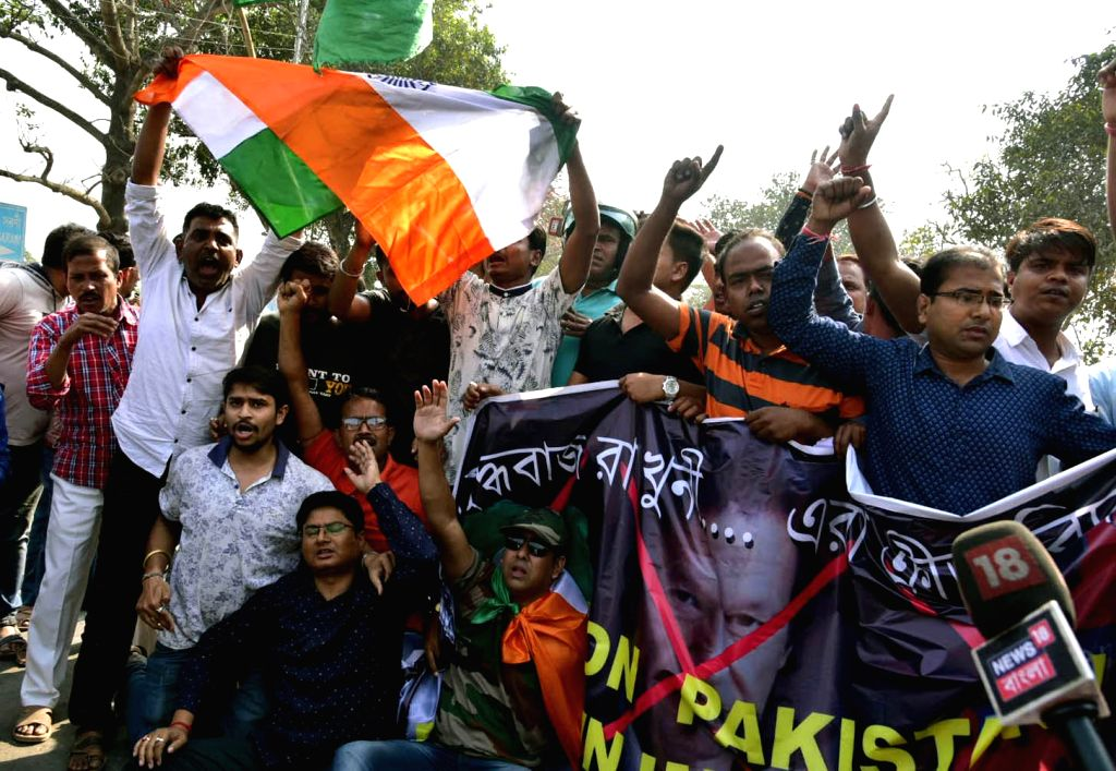 Bhartiya Janta Yuva Morcha (BJYM) activists stage a demonstration outside Eden Gardens to demand removal of pictures of Pakistani cricketers including Pakistan Prime Minister Imran Khan; in ... - Imran Khan